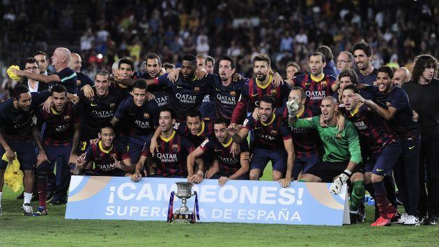 FIESTA 'CULÉ'. El Barcelona se impuso en la Supercopa, aunque lo hizo sin brillo. El Atlético fue un digno rival. (AFP)