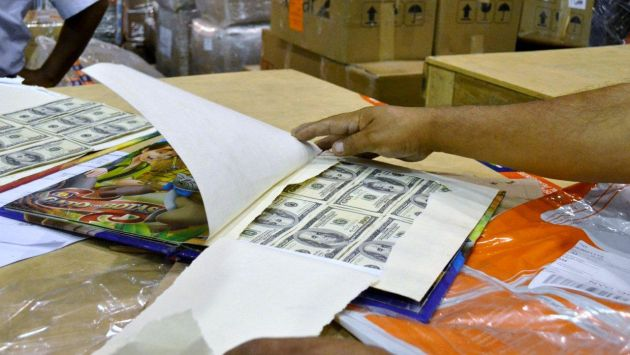 Sunat incautó 70 mil dólares falsos ocultos en libros infantiles. (Foto:Sunat)