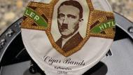 El rostro de Hitler aparece en bote de crema para café. (ww.20min.ch)