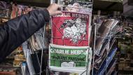 Nuevo número de Charlie Hebdo dedicada su portada al partido ultraderechista Frente Nacional. (AFP)