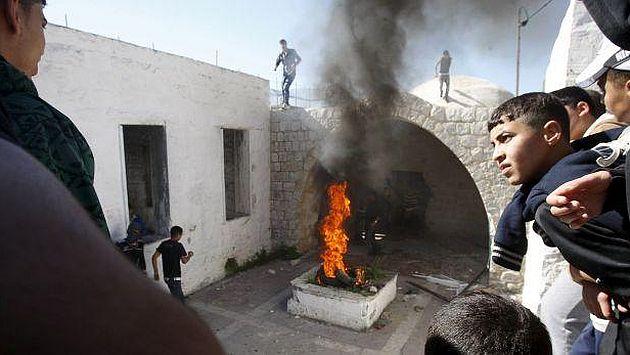 Más allá del territorio. Buscan provocar a los israelíes destrozando símbolos de culto. (Reuters)