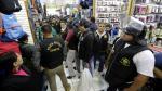 Municipalidad de Lima y la Policía decomisan más de 500 celulares de dudosa procedencia en galería de la Av. Grau [Fotos] - Noticias de compra de armamentos
