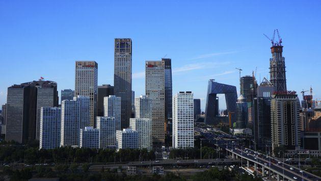 PBI de China sería de 6.6% este año y 6.5% en el 2017, según sondeo. (Beijing|AP)