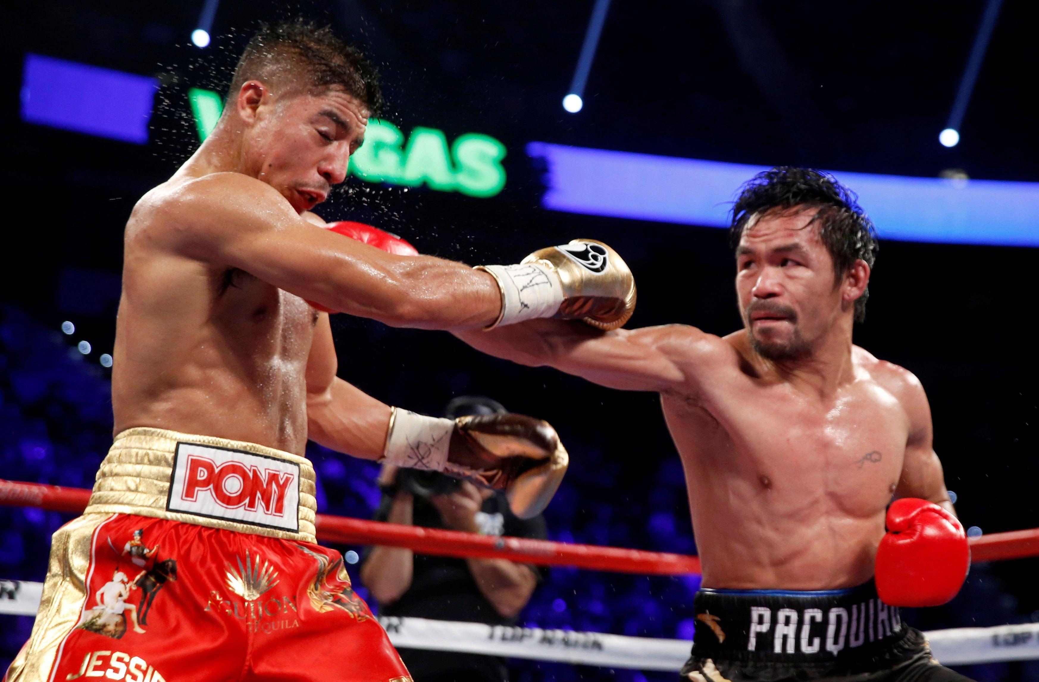 Boxeador Manny Pacquiao arrebata el título welter a Jessie Vargas