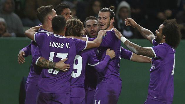 Real Madrid venció 2-1 a Sporting de Gijón y mantiene liderato de la Liga española. (AFP)